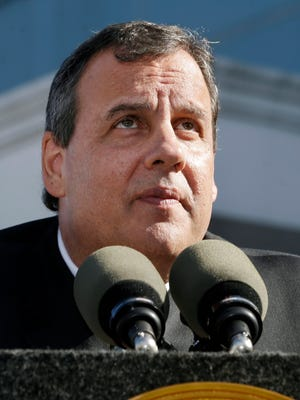 New Jersey Gov. Chris Christie listens to a question after an outdoor bill signing ceremony Wednesday, April 29, 2015, in New Brunswick, N.J. Christie signed a pair of bills Wednesday aimed at helping to curb prescription drug abuse in the state.