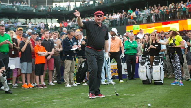 """Cardinals head coach Bruce Arians tries to excite the crowd during the 2015 Phoenix Suns Charities """"Shot at Glory"""" on the 16th hole following the Annexus Pro-Am at the Waste Management Phoenix Open at TPC Scottsdale."""