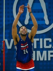 Denzel Valentine participates in the vertical jump drill Friday at the NBA Combine in Chicago.