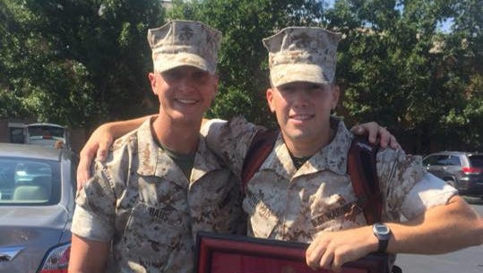 Michael Donovan, right, of Appleton, earned top honors from Quantico's Officer Candidates School this summer.