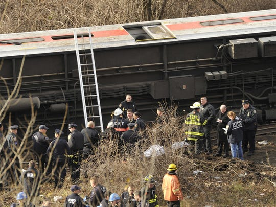 Emergency workers at the Bronx derailment. .