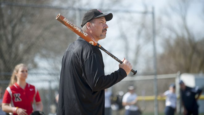 Kingsway softball coach Dave Dominik warms up his players prior to an April 5 game between the Dragons and GCIT played at Bankbridge Regional Middle  School. Dominik recently finished chemotherapy after he was diagnosed with colorectal cancer last June.