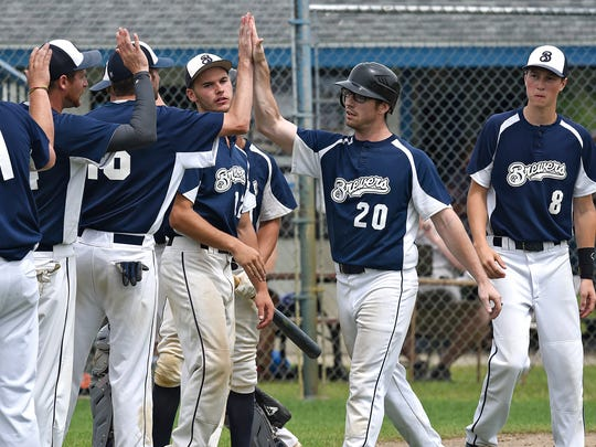 Sam Iten is congratulated by Luxemburg Brewers teammates after hitting a home run in the first inning of Sunday's Central Valley League game against St. Augusta in Luxemburg.