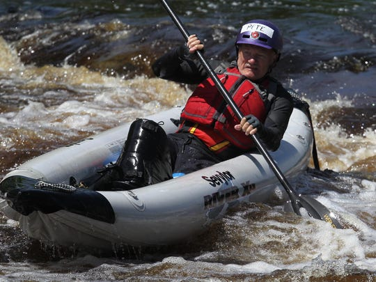 Disabled U.S. Marine Corps veteran Pete Mittelstaedt of Elkhorn navigates a rapids in an inflatable kayak as Wausau Whitewater hosted its third annual Team River Runner Weekend at Wausau's Whitewater Park on June 6.