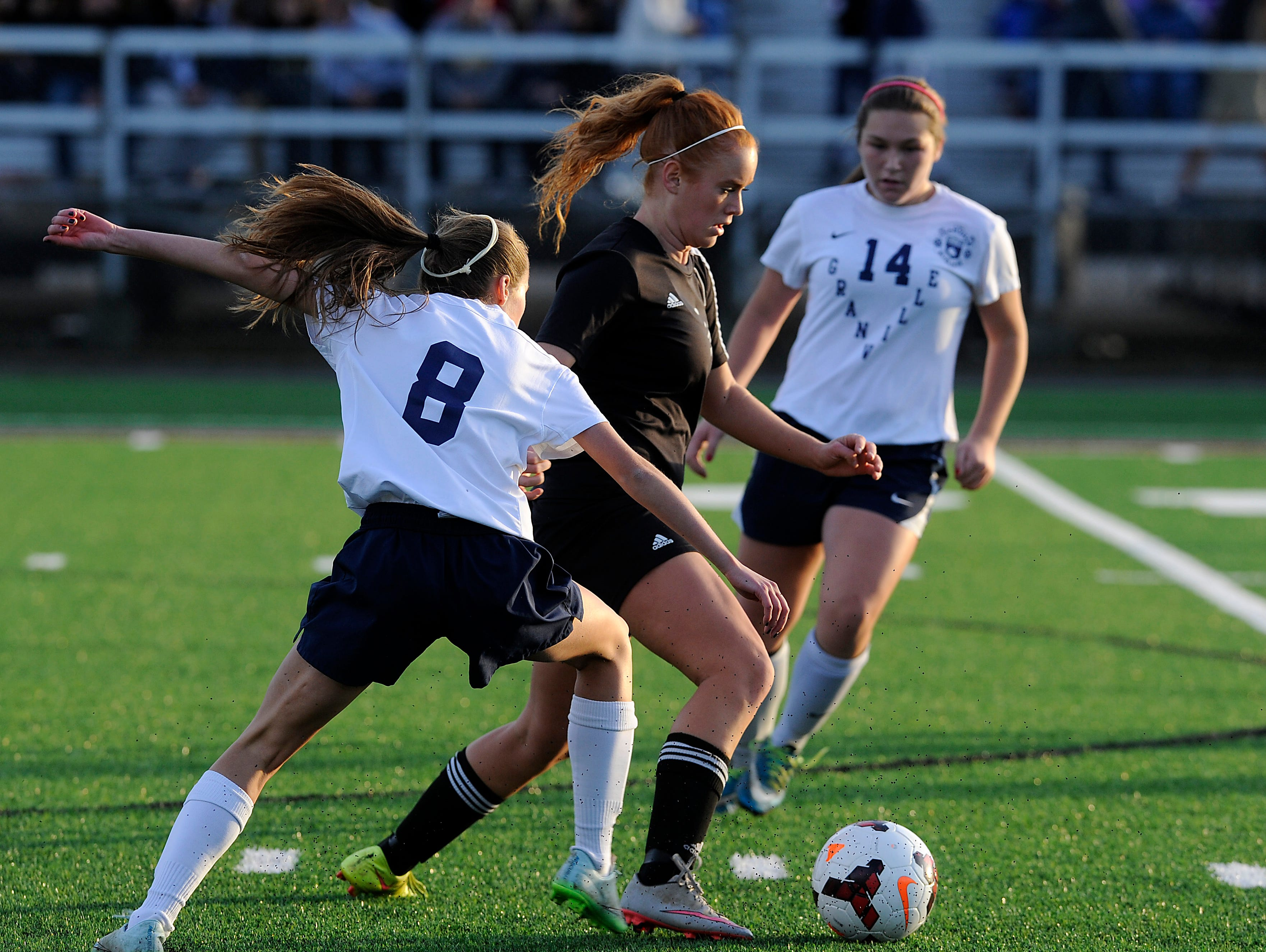 Tri-Valley's Kylee Ritchie steals the ball from Granville's Alyssa Christian. Granville defeated Tri-Valley 10-1 in the Division II regional final on Saturday, Nov. 7, 2015, at White Field in Newark. The Blue Aces will advance to play Indian Hill in the state tournament.