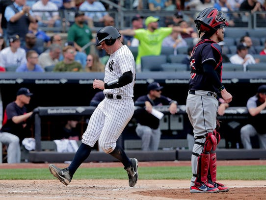 New York Yankees' Austin Romine scores on a sacrifice
