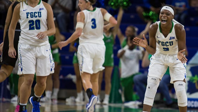 Kaneisah Atwater, right, encourages her teammates during the second half of the NIT game against Wake Forest at Alico Arena Monday evening.  The FGCU womenÕs basketball team defeated Wake Forest 67-48 in the WomenÕs  NIT on Monday night (3/21/16) at Alico Arena during Round 2 action of the tournament taking them into the Sweet 16 round. The Lady Eagles will now face  Tulane on Wednesday night for a chance to advance to the Elite Eight.