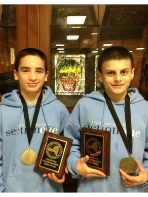 Matt Grippi (left) and Grant Cuomo (right) pose with their medals after winning youth state titles as sixth-graders in 2012. They'll both be competing for high school state championships this weekend in Albany.