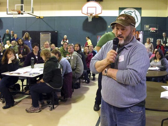 Ted Hoyt talks to fellow residents at the annual town meeting Tuesday in Tunbridge. The town voted against a large-scale development by a Utah businessman that would be based on the papers of Mormon leader Joseph Smith.