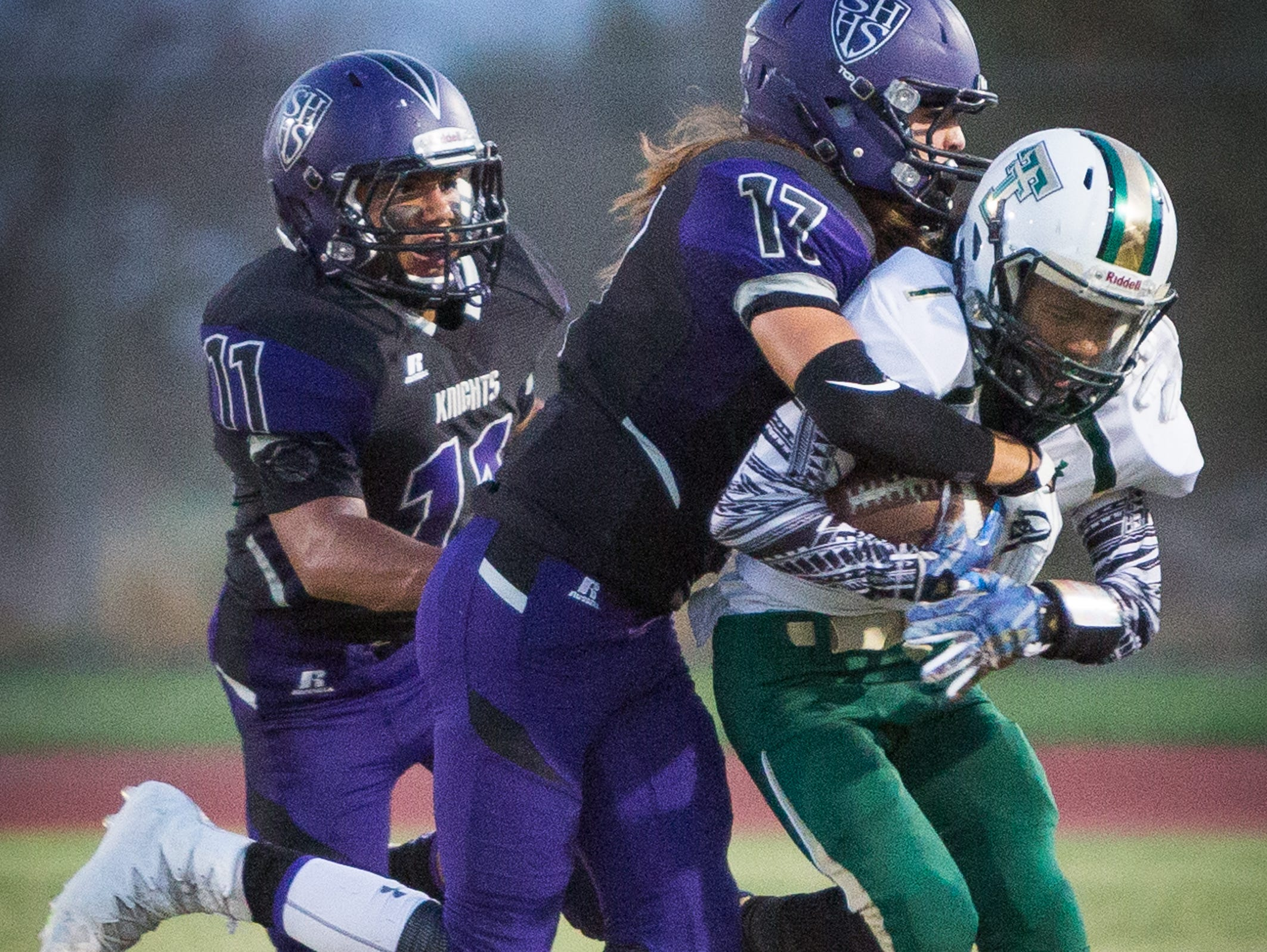 Jason Lang (#17) stops Tyree Chaisson (#7) during the Tahquitz High School vs Shadow Hills High school football game.
