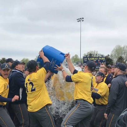 Augustana players douse coach Tim Huber with ice after