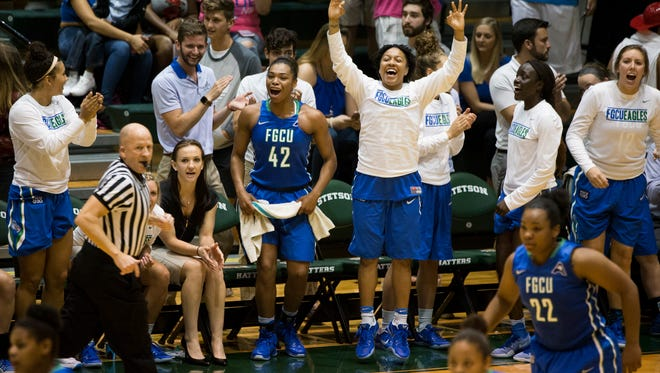 The FGCU bench erupts after a three-pointer is made in the first half of action during the Atlantic Sun championship game at the Edmunds Center Sunday in DeLand, FGCU went on to win the title and seal a bid into the NCAA tourney.