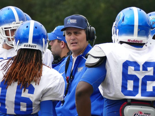 UWF football coach Pete Shinnick, talking to players during fall scrimmage, has seen dramatic change in recruiting process with social media.