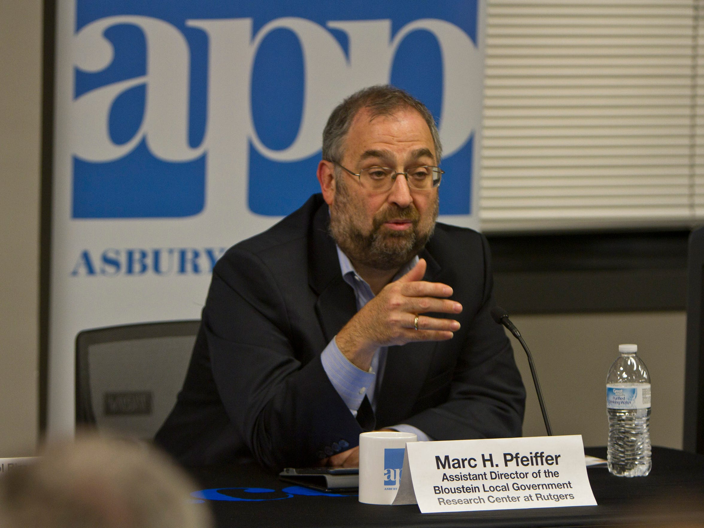 """Marc H. Pfeiffer, Assistant Director of the Bloustein Local Government Research Center at Rutgers, answers questions regarding taxes during the Asbury Park Press' recent """"Taxed Out"""" Town Hall. Neptune, NJ Thursday, October 15, 2015 @dhoodhood"""