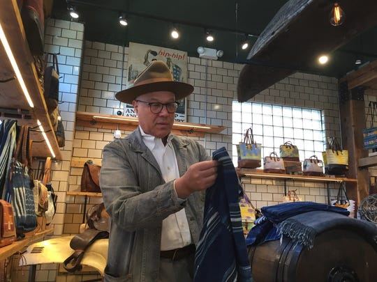 Will Adler, the founder of Will Leather Goods, shows off some of the items on sale at the Midtown shop on Monday, Nov. 2, 2015. The store recently closed and is being converted into an Italian restaurant and market.
