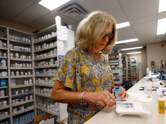 Margaret Jodelka, a pharmacist at Oakhust Pharmacy, is shown filling orders in the Ocean Township store on Route 35 Monday, August 6, 2018.