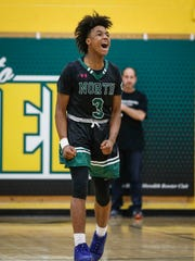 Des Moines North junior point guard Tyreke Locure reacts