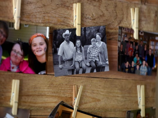 Photos of family hang on the wall in Kathy Steever's