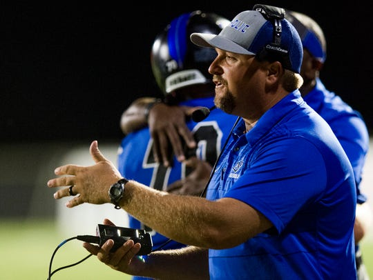 Catholic coach Aubrey Blackwell coaches against St.
