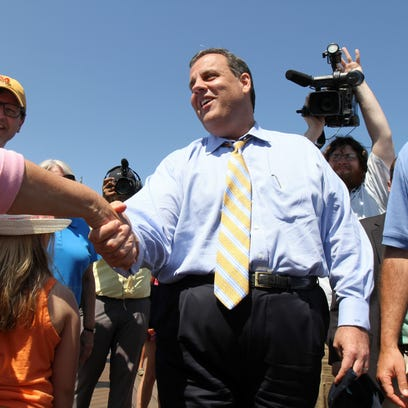 Gov. Chris Christie greets people along the boardwalk