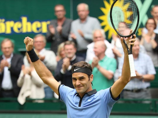Switzerland's  Roger Federer celebrates his victory in the final match against  Germany's Alexander Zverev at the Gerry Weber Open tennis tournament in Halle, Germany, Sunday, June 25, 2017.  (Friso Gentsch/dpa via AP)