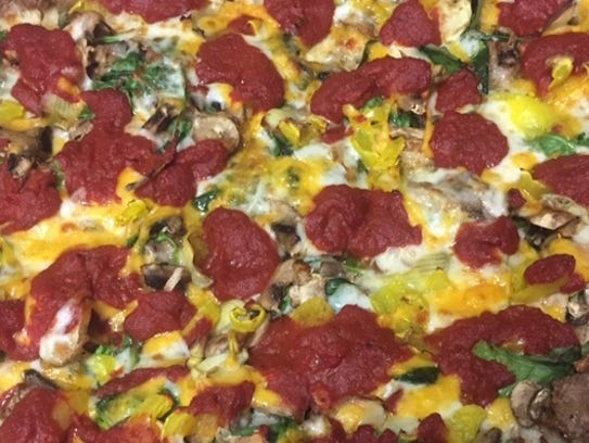 Eric's offers a number of signature pizzas but also lets customers fully customize their orders with fresh ingredients.