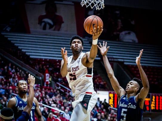 Ball State's Tahjai Teague shoots past Jackson State's