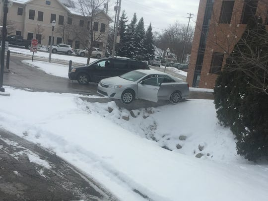 Salvador Alvarado's 2013 Toyota is stranded on a curb on Feb. 1, as shown in a photo taken by good Samaritan Arnie Feguer. Railings have since been installed to prevent further accidents.