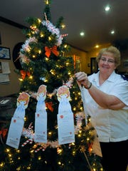 Ruthanne Bigler, of the Salvation Army, posts angels Wednesday, Dec.2, 2015 at the Angle Tree inside Chambersburg Family Diner. The Angel Tree is an over 20 year-old program designed for customers to leave gifts for children to brighten their Christmas.