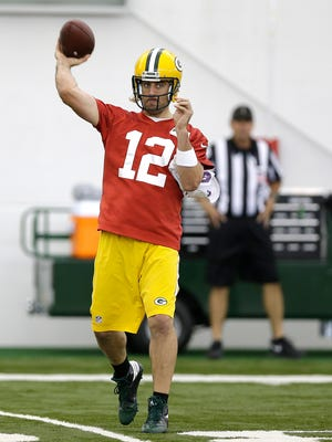 Green Bay Packers quarterback Aaron Rodgers throws the ball during OTA practice inside the Don Hutson Center on Monday, June 6, 2016.