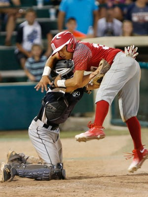 Hoosier North catcher Owen Walbaum tags David Castro of Mexico out at home for the final out of the bottom of the sixth inning Wednesday, August 10, 2016, in the championship of the Colt World Series at Loeb Stadium. Mexico defeated Hoosier North 6-5 to win the championship.