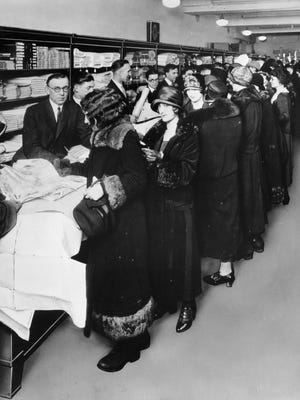 Women crowd the counters of one of the first Sears retail stores in 1925.