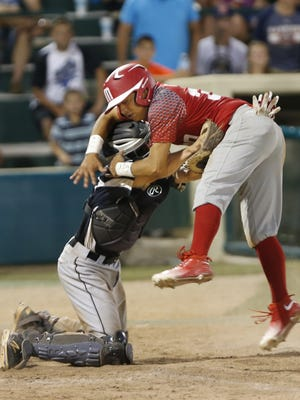 Hoosier North catcher Owen Walbaum tags David Castro of Mexico out at home for the final out of the bottom of the sixth inning during the championship of the 2016 Colt World Series at Loeb Stadium. Mexico defeated Hoosier North 6-5.