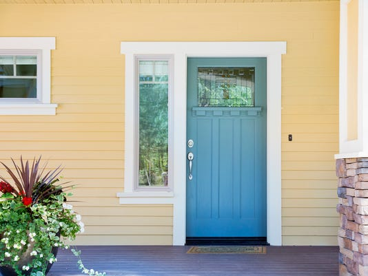 Front entrance of a home with blue door