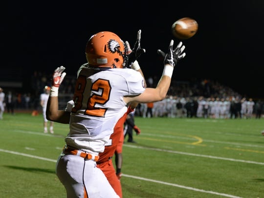 Brother Rice receiver Reese Trahey hauls in a TD pass