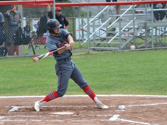 Marshall's Kole DeLand takes a swing during this Division 2 district tournament game on Saturday.