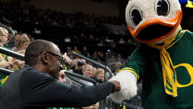 Dec 11, 2016; Eugene, OR, USA; Oregon Ducks mascot fist bumps Oregon Ducks football head coach Willy Taggart at the Oregon Ducks basketball game against the Alabama Crimson Tide Matthew Knight Arena. Mandatory Credit: Scott Olmos-USA TODAY Sports