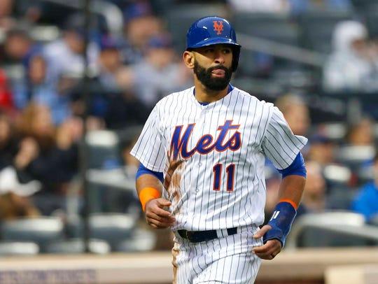 New York Mets left fielder Jose Bautista scores in