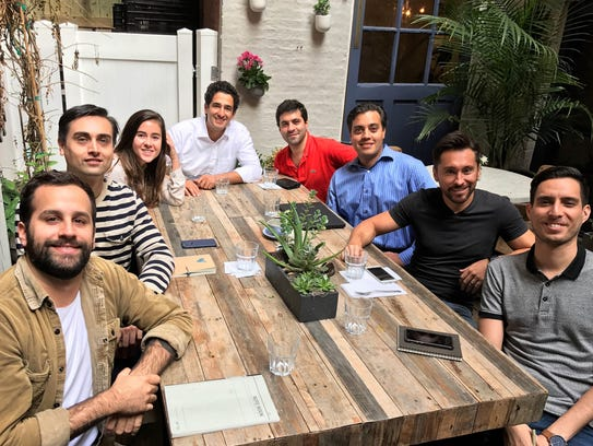 Carlos Garcia, El Paso-Juárez native, center, with some of his small staff on the patio at Finhabits' New York office. Two other area natives and UTEP graduates are : Adal Gutierrez, left, striped shirt, vice president of marketing and communications; and Jose Luis Trejo, right bottom, head of consumer engagement.