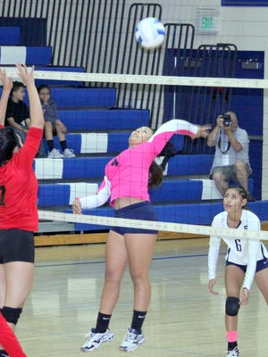 Makayla Guerra goes up to spike the ball during action Thursday night against rivals Cobre High. She had five kills on the night.