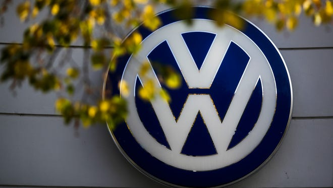 In this Oct. 5, 2015 file photo the VW sign of Germany's car company Volkswagen is displayed at the building of a company's retailer in, Berlin, Germany.