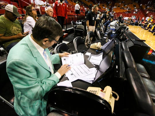 Craig reads through his notes before the game. Craig Sager, the eccentric TNT/TBS NBA sideline reporter began his broadcast career with WINK-TV in Fort Myers in the mid-1970s. HeÕs now renewing his very public battle against leukemia while still working NBA games. He worked the Chicago Bulls at Miami Heat game on Thursday, April 7, 2016.