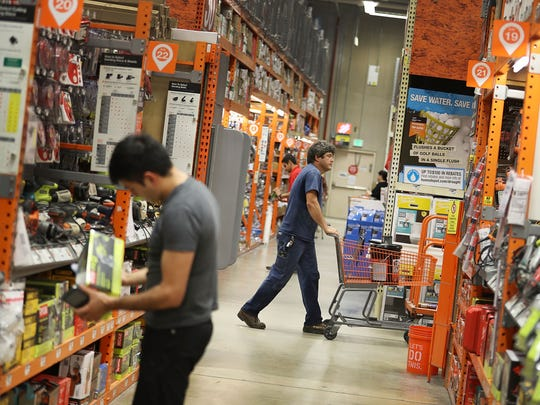 Customers shop in a Home Depot store  on May 17, 2016,