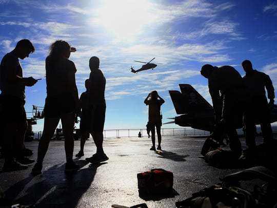 Members of the 181st Special Operations Weather Team prepare to parachute from a UH-60 Blackhawk during a training exercise as they conduct a deliberate static line personnel parachute drop into Corpus Bay on Friday, July 28, 2017, at the USS Lexington Museum on the Bay in Corpus Christi.