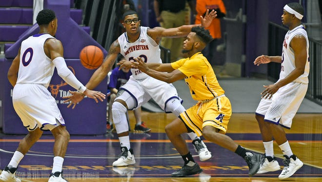 Northwestern State's Ishamel Lane (center) defends against LSU-Alexandria on Tuesday night.