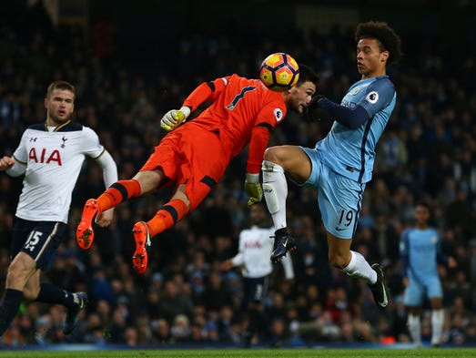 Manchester City's Leroy Sane chests the ball past Tottenham