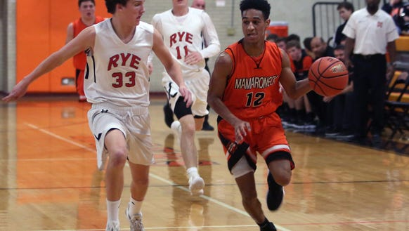 Rye defeated Mamaroneck 53-34 in boys basketball action