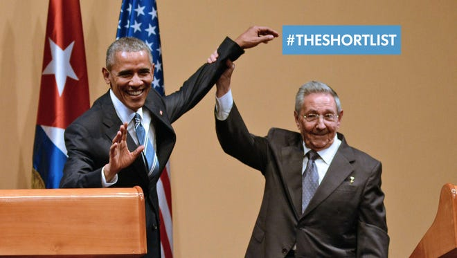 Cuban President Raul Castro raises President Obama's hand during a joint press conference at the Revolution Palace in Havana on Monday. Awkward.