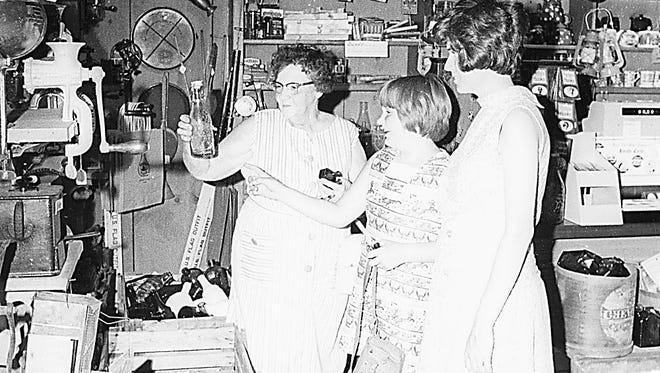 Shoppers look over items at a Wheaton Village store in 1971, when Wheaton Village was one of Millville's newest attractions.