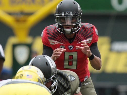QB Marcus Mariota, Oregon.<br /> 2013 stats - 3655 passing yards, 31 TD, 4 INT.